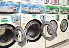 A ow of coin-operated washing machines in a local laundromat.