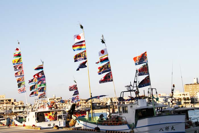 Fishing boats in Itoman Port fly good-luck banners on the Lunar New Yaer.