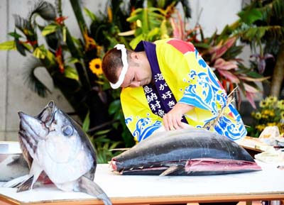 Tuna cutting show draws attention to local fishing industry.
