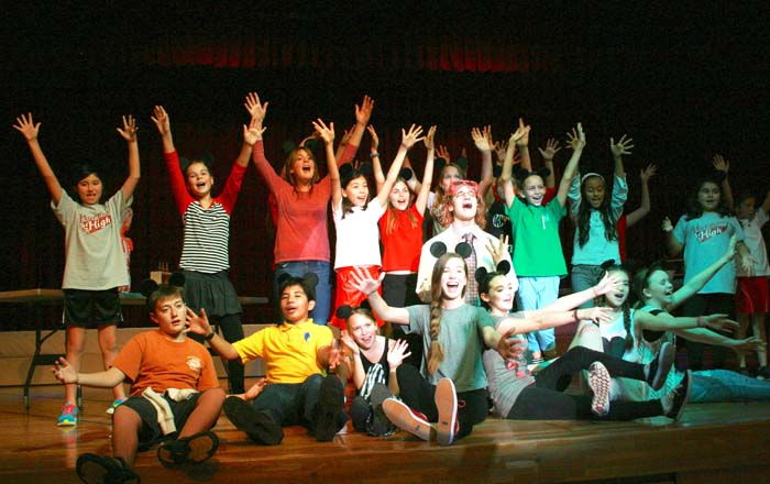 "The cast of ""Harmony High"" consists of 34 youths ages 9 to 17. (Photo by Ashley Green)"