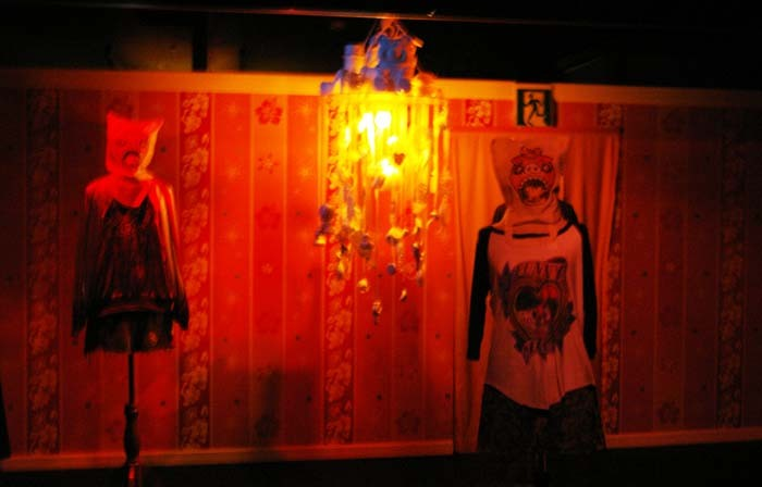 Students from Yoshimoto Kogyo Actors' School play the roles of 'majimun' specters at Hapinaha's haunted house.