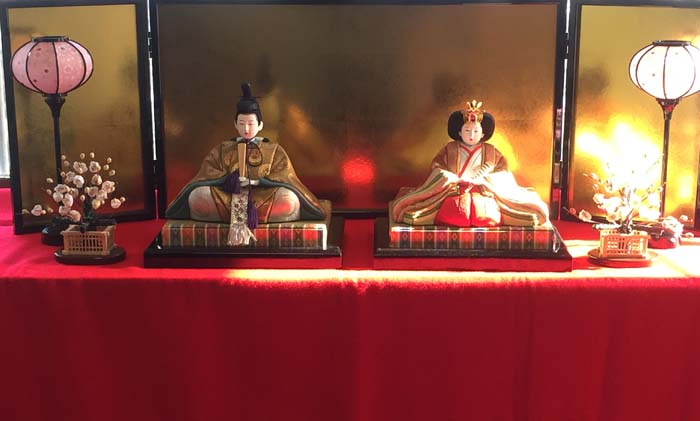 A hina doll dislay always has the emperor and empress on top with the rest of the court placed on tiers below the royals.