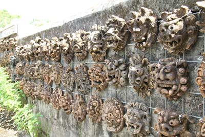 This wall of shisa faces is in Kitanakagusuku.