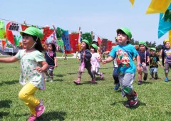 Children enjoy among koinobori streamers at Peace Memorial Park in Mabuni, Itoman.