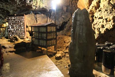 Kin Distillery uses a cave under Kannon Temple as a storage for awamori.