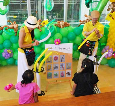 Balloon art entertains the younger party goers at Orion Happy Party.