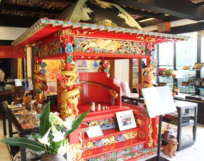 A replica of a royal Ryukyu palanquin greets the visitor on the first floor.