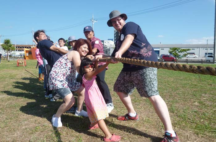 The International Sports Day features plenty of activities, including a tug-of-war.