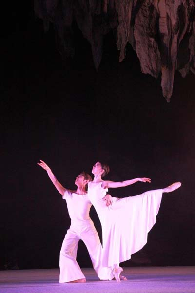 The cave forms a dramatic background to the performance.