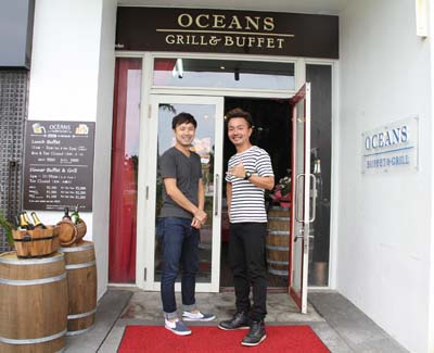 "Oceans Buffet & Grill owner Tsuyoshi Tanaka (left) and manager ""Yassy""."