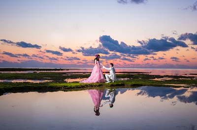 A sunset in the background makes a perfect background to a memorable photo.