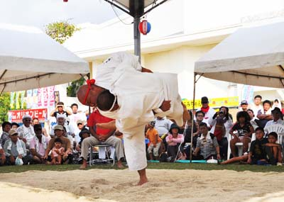 Besides the animals, men also compete to see who's the strongest in Okinawan-style contest.