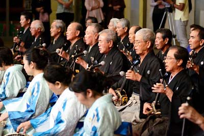Members of the Okinawa City Association of Performing Arts Organizations perform the classical part of the Niutu Umachii event.