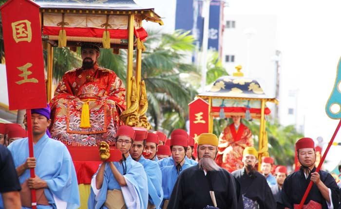 The King and Queen are carried in their palanquins the entire length of Naha's Kokusai Street.