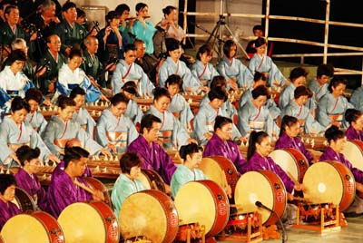 About 300 players perform Okinawan classical music on Saturday evening.
