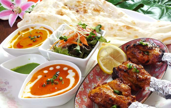 Chicken Tandoori Kebab set with two kinds of curry to choose from, chicken, and salad.