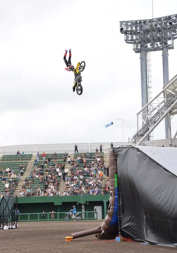 A motocross driver shows he can jump.