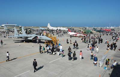 JASDF and Japan's Coast Guard aircraft is on static display during the Churashima Air Fest.