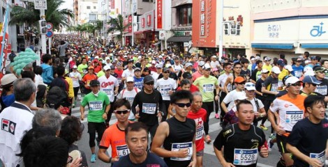 Runners fill Kokusai Street in Naha shortly after the morning start of the marathon.