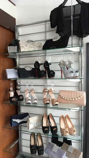 The shop's selection covers everything one needs with a party dress, such as shoes, bags and accessories.