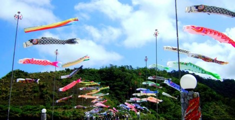 Carp streamers fly along Haneji Dam embankment.