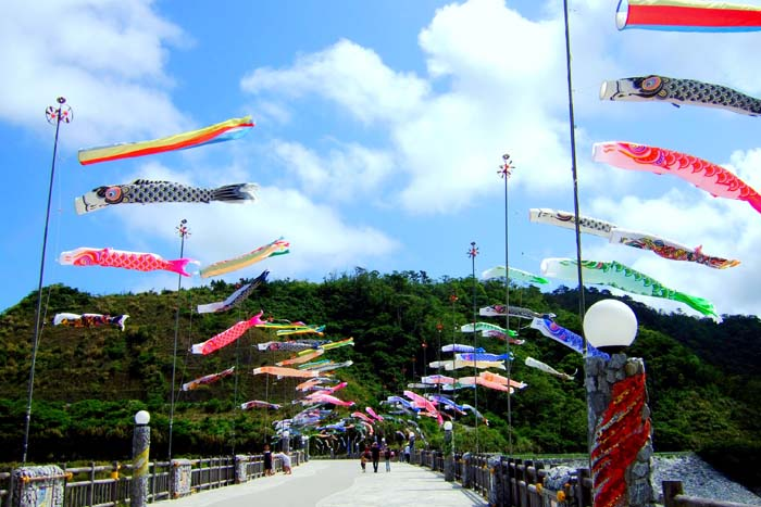 Carp streamers fly along Haneji Dam embankment.