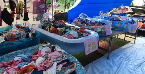The flea market specialty is new and used children' clothes and items.